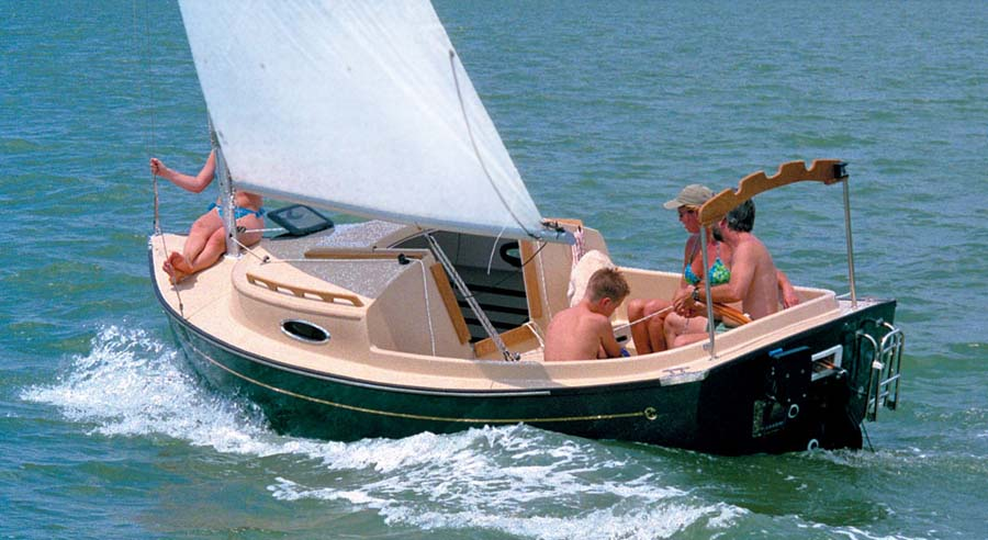 family sailing on a compac yacht