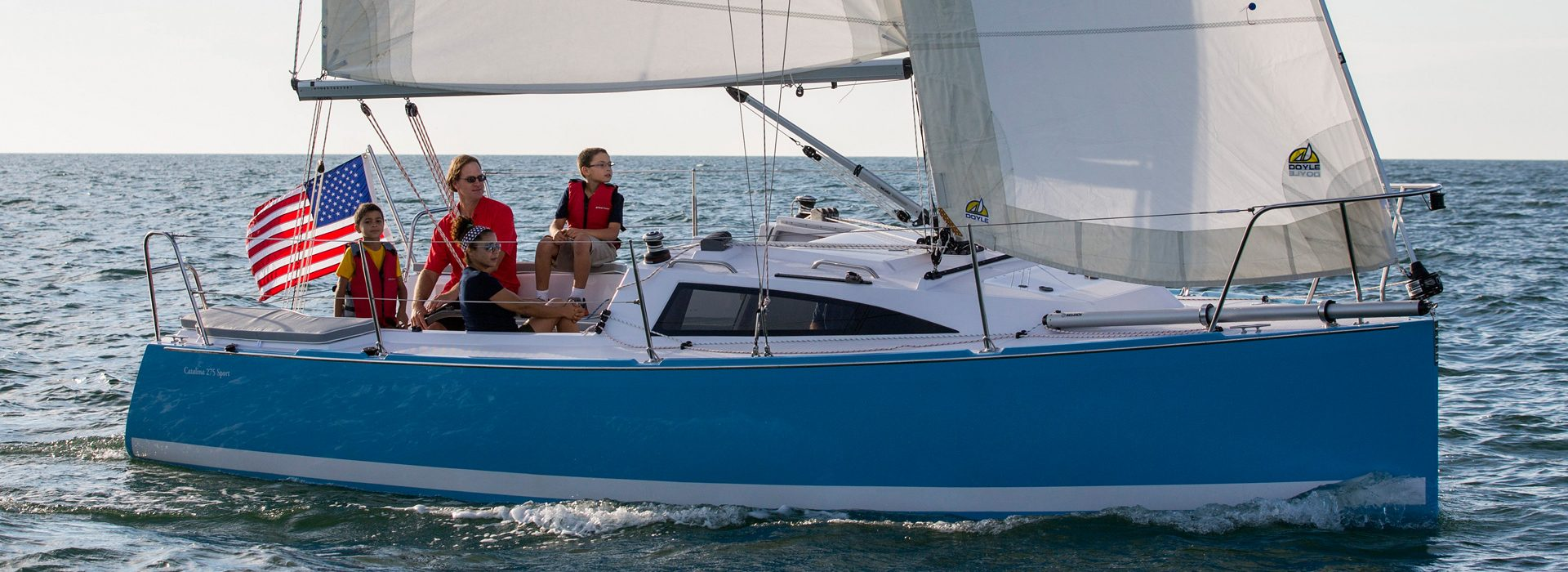 Family sailing on a catalina yacht