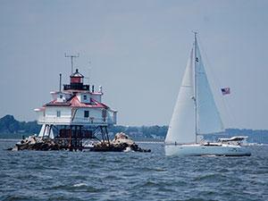 sailing past a lighthouse