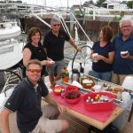 happy group eating on new boat
