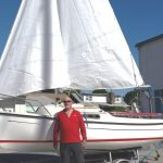 owner posing with new sailboat