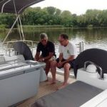 new owner relaxing on boat