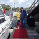 new owners posing on dock