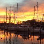 view of marina slips at sunset