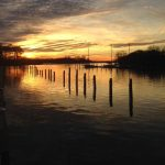 dock pilings at sunset