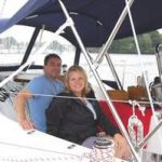 happy couple sitting on new boat