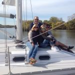happy family on new sailboat