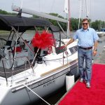 happy owner posing with boat