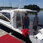 happy owners aboard their new boat