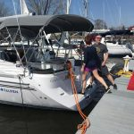 happy owners boarding new boat